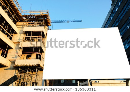 Blank billboard on the construction site - stock photo