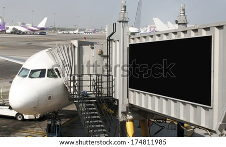 Blank billboard on the gangway in the airplane - stock photo