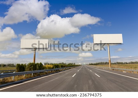 blank billboard on the highway  - stock photo