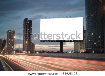 Blank billboard on the highway during the twilight with city background with clipping path on screen.- can be used for display your products or promotional - stock photo