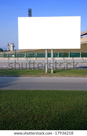 Blank billboard on the street at sunset