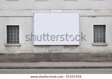 blank billboard on the wall - stock photo