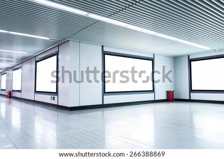 Blank billboard on the wall in airport  corridor - stock photo