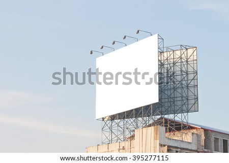 Blank billboard on top of building ready for new advertisement - stock photo