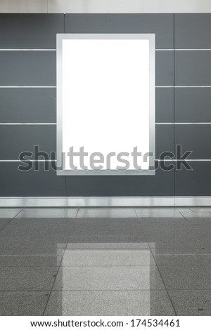 Blank billboard or poster located in underground hall - stock photo