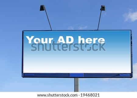 Blank billboard over blue sky, put your own text here - stock photo