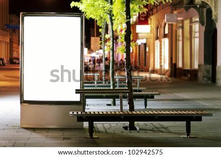 Blank billboard panel at night - stock photo