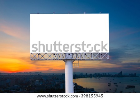 Blank billboard ready for advertisement in city downtown with sunrise background. - stock photo