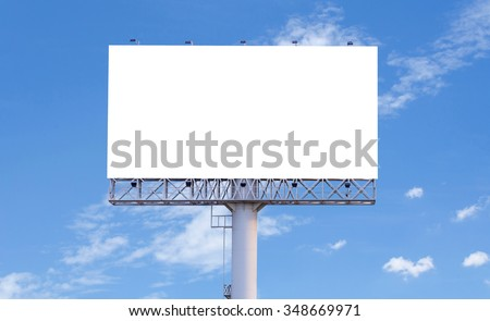 Blank billboard ready for new advertisement with blue sky background. - stock photo