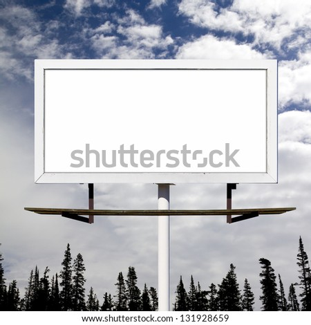 Blank billboard sign against blue sky wilderness background mockup - stock photo