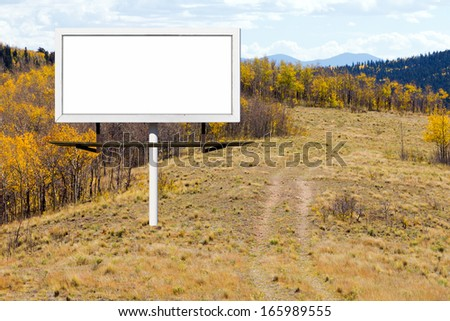 Blank billboard sign along a mountain trail with golden fall aspen trees in Colorado - stock photo