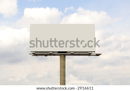 Blank Billboard sign - clean with blue cloud filled sky in background - stock photo