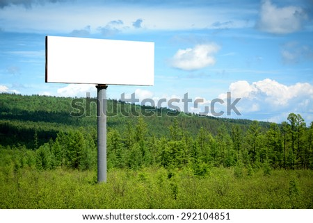 Blank billboard sign in forest - stock photo