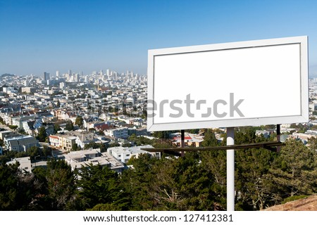 Blank billboard sign with white background above the San Francisco, California Skyline - stock photo