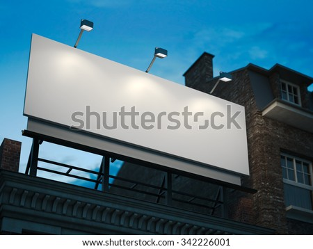Blank billboard standing on classic building in the night - stock photo