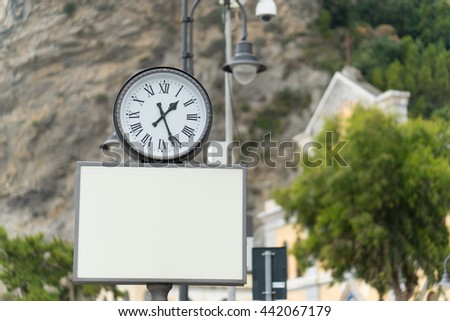 Blank billboard with analog clock for your design - stock photo