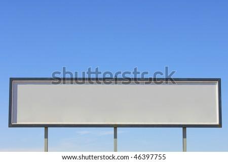 Blank billboard with blue sky - stock photo