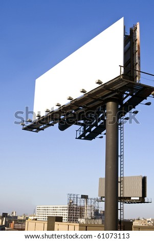 Blank billboard with cityscape - stock photo