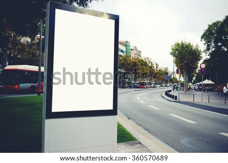 Blank billboard with copy space for your text message or promotional content, empty public information board in the big town, advertising mock up banner in metropolitan city on roadside - stock photo