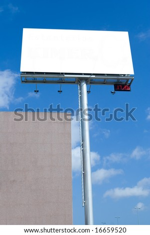 Blank billboard with digital clock against blue sky during rush hour - stock photo