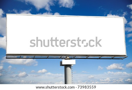 Blank billboard with space for your advertisement against blue sky - stock photo