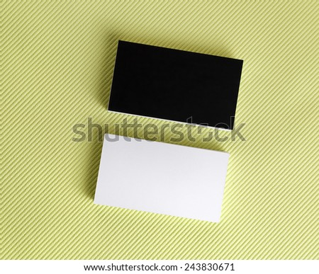 Blank black and white business cards on a green background. Template for ID. Top view. - stock photo