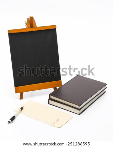 Blank black board with wooden stand and books. Isolated on the white background. - stock photo