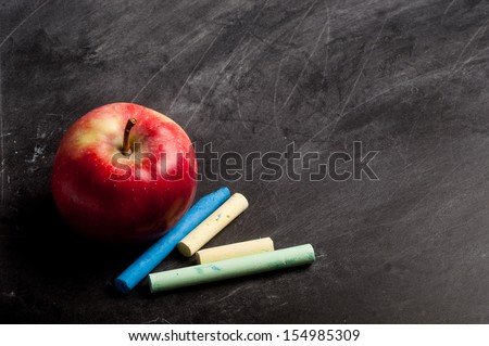 blank black chalkboard with chalk and apple - stock photo