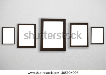 Blank black frame attached to a buildings wall.