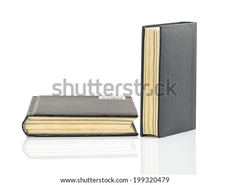 Blank black hardcover book on white glossy background with reflection - stock photo
