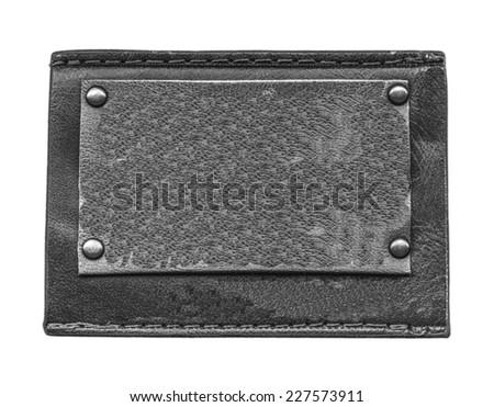 blank black leather jeans label isolated on white - stock photo