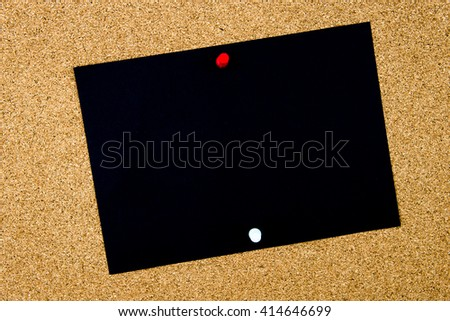 Blank black paper note pinned on cork board with white and red thumbtacks, copy space available - stock photo