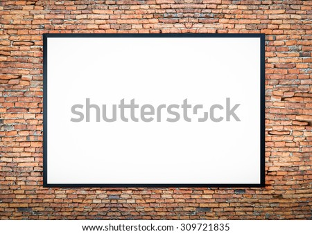 blank black picture frame on the old brick wall  - stock photo