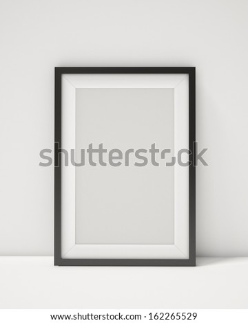 blank black picture frame on the white interior background - stock photo