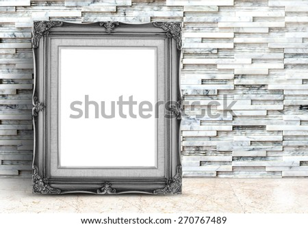 Blank black Vintage frame on marble floor and white stone tiles wall,Template mock up for adding your design. - stock photo