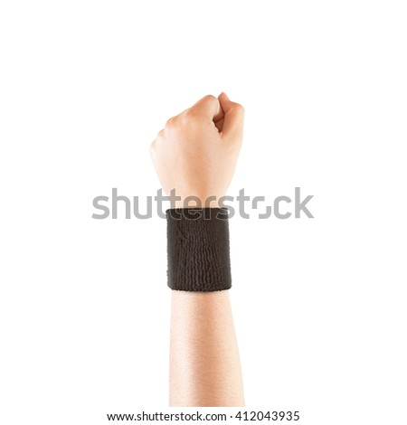 Blank black wristband mockup on hand, isolated. Clear sweat band mock up design. Sport sweatband template wear on wrist arm. Sports support protective bandage wrap. Bangle on the tennis player. - stock photo