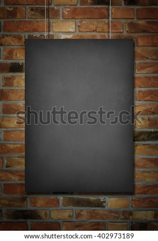 Blank blackboard at a brick wall background with space for text