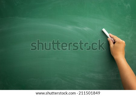 Blank blackboard / chalkboard, hand writing on green chalk board holding chalk, great texture for text - stock photo