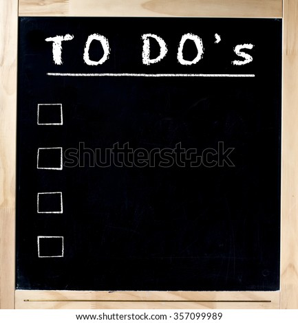 Blank blackboard in wood frame with blank to do list isolated - stock photo