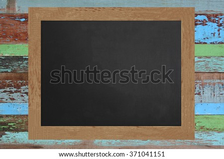 Blank blackboard on Wooden texture background. - stock photo