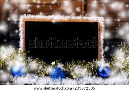 Blank blackboard with christmas decoration and snowflake. - stock photo