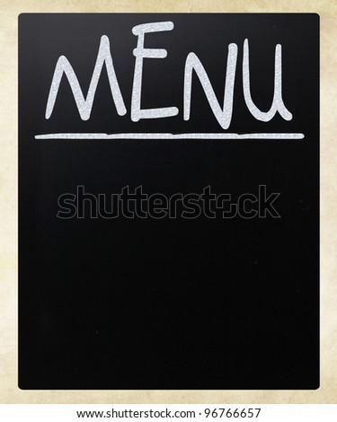 Blank blackboard with white chalk smudges used a restaurant menu. - stock photo