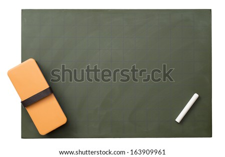 Blank blackboard with white chalks and eraser - stock photo