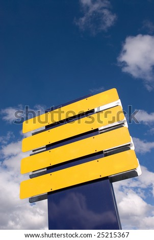 Blank Blue and Yellow Sign over Cloudy Sky - stock photo