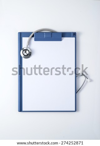 Blank blue clipboard with stethoscope isolated on white with clipping path. Medicine concept - stock photo