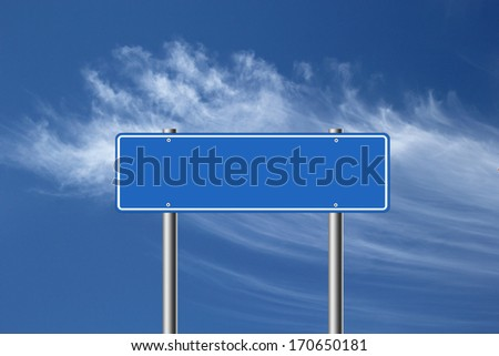 Blank blue road sign isolated on blue sky background.