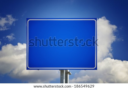 Blank Blue Road Sign with Sky and Clouds - stock photo