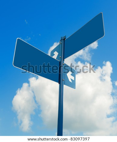 Blank blue road signs in bright sky, clipping path. - stock photo