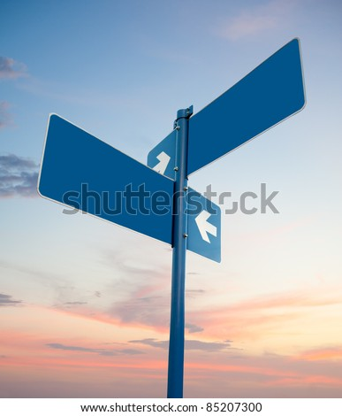 Blank blue road signs in dusk sky, clipping path. - stock photo
