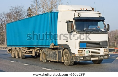 """Blank blue tractor trailer truck on background of trees part of """"business vehicles"""" series - stock photo"""